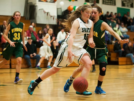 Winooski's Amanda Nattress (15) dribbles the ball past Windsor's Ashleay Wilcox (4) during the girls basketball game on Feb. 18.