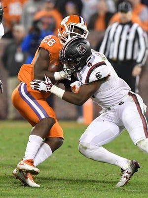 South Carolina linebacker Bryson Allen-Williams (4) delivers a hit to Clemson running back Tavien Feaster (28).