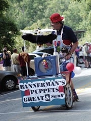 Glenn Bannerman entertains the crowd during the 2001 Fourth of July parade in Montreat.