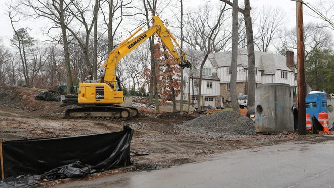 Construction machinery works on a property along Durham Road in the Town of Mamaroneck this week.