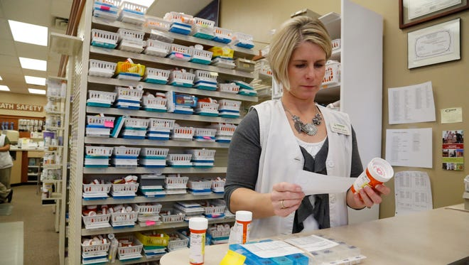Pharmacist Pam Key works in the Hammer Pharmacy on Grand Avenue in Des Moines' East Village. The pharmacy was sold recently to GRX Holdings of West Des Moines.