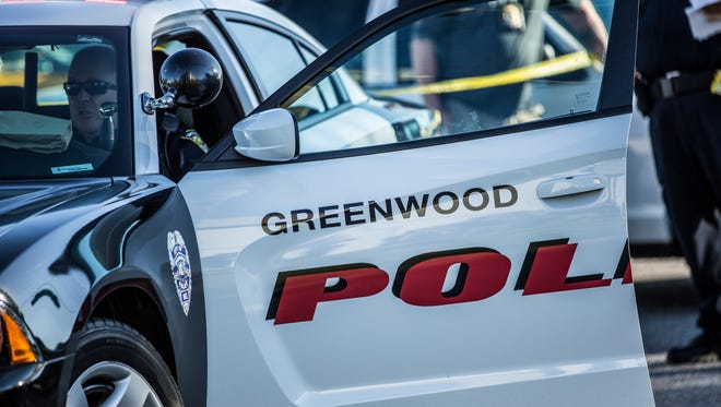 A Greenwood police officer sits in his squad car at the scene of an officer-involved shooting in the 7900 block of Shelby Street on June 27, 2016.
