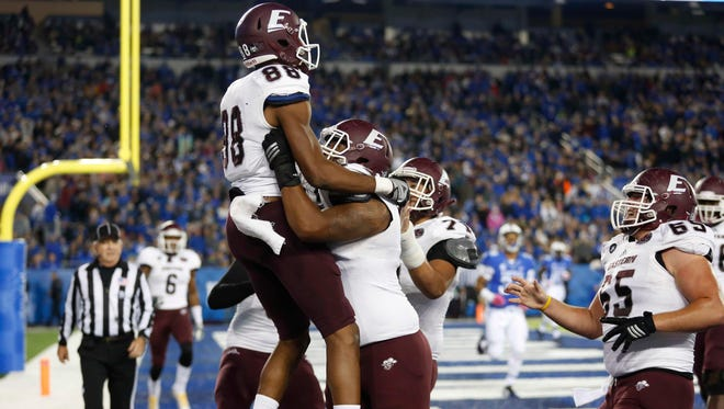 Eastern Kentucky wide receiver Devin Borders (88) celebrates with offensive lineman Justin Adekoya (79) after scoring a touchdown against the Kentucky Wildcats  in the first half at Commonwealth Stadium on Oct. 3, 2015.