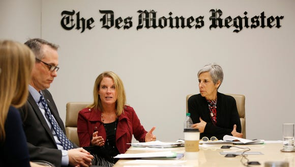 Kristi Knous with the Community Foundation of Greater Des Moines (center) sits with Jay Byers (left) and Angela Connolly as they talk about Capitol Crossroads 2.0 Thursday, Jan. 26, 2017 with the Des Moines Register's editorial board.