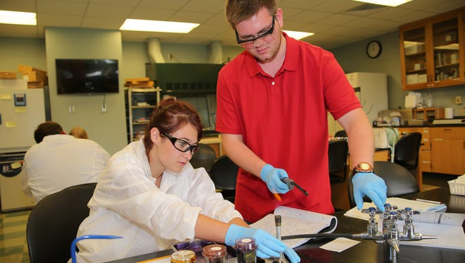 Alexander Dies of Lebanon works with fellow high school student Donovan Diehl as they start a gram staining lab project, a diagnostic tool often used in microbiology.