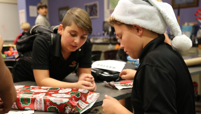 Middle school students from Oaks Christian School wrapped presents this week to give to families this holiday season.