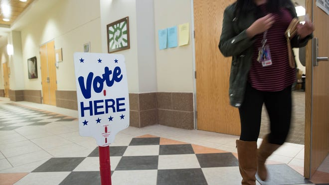 Voting in the School Bond Election Tuesday February 6, 2018, at the Doña Ana County Government Center.