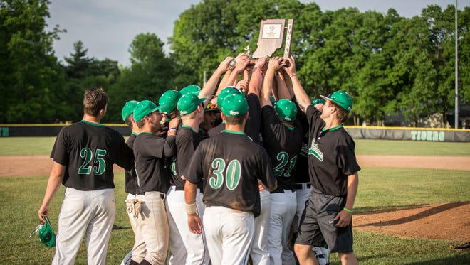 Yorktown's baseball team hold up the sectional trophy following a win of the IHSAA Class 3A Baseball Sectional Championship on May 8 at Yorktown High School. Yorktown won with a final score of 2-0 against Guerin Catholic which puts them in the Bellmont Regional next weekend.