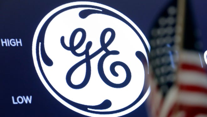 The General Electric logo appears above a trading post on the floor of the New York Stock Exchange on June 26, 2018.