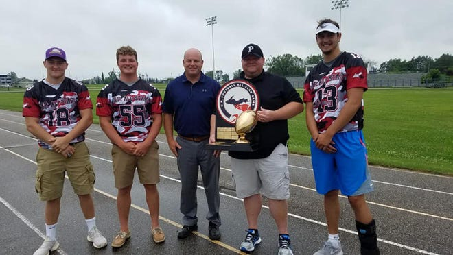 Pickford football's U.P. All-Star Game representatives got together this past Sunday to collect gear distributed by event organizer Todd Goldbeck. Pictured from left to right are Jimmy Storey, Isaiah May, coach Steve May, coach Duncan Martin and Nick Edington. Pickford's Stephen LaMothe and Blaine Burnaby, not pictured, were also All-Star Game selections.