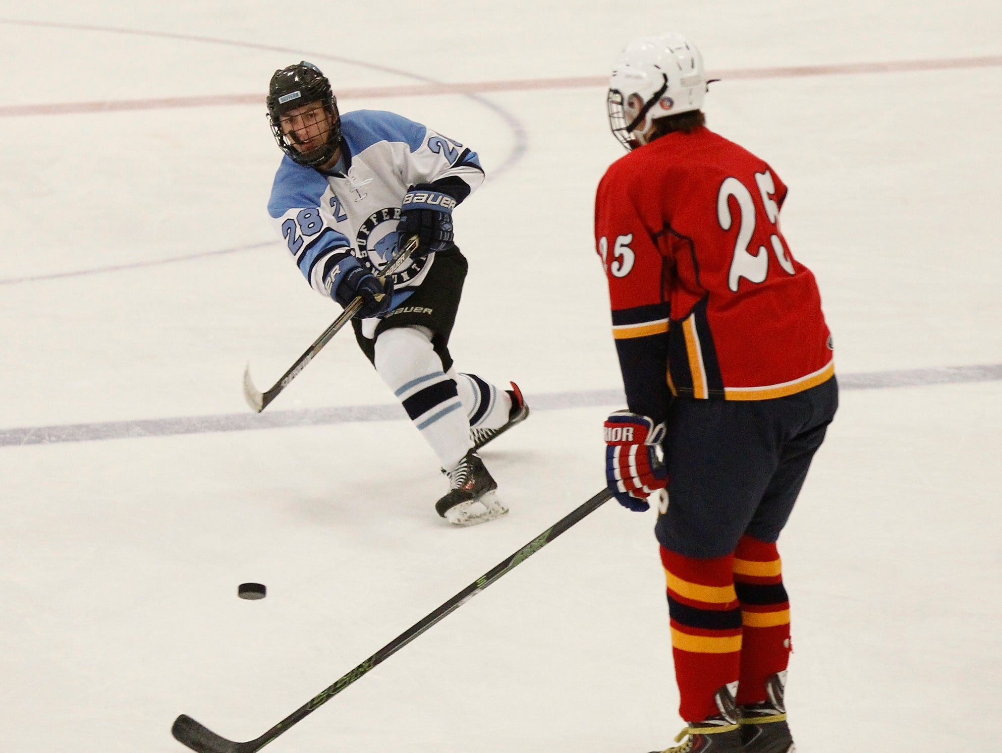 Suffern's Nick Vecchione (28) takes a shot from the red-line during a varsity ice hockey game at Sport -O-Rama in Monsey on Saturday, Nov. 28, 2015.