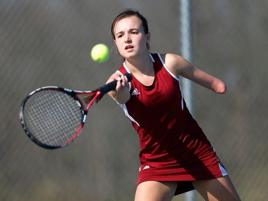 McCutcheon's Megan Skadberg with a return in her match against Teja Kakani of Harrison at No. 2 singles Thursday, April 14, 2016, at Harrison High School.