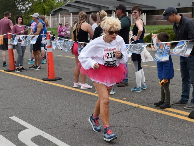 A runner nears the finish line in annual Moms on the