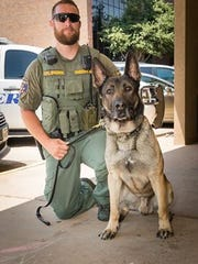Wichita County Sheriff's Office Corp. Josh Brown and K-9 Officer Kimbo are seen outside of Frank and Joe's Coffee Shop, one of their favorite places.