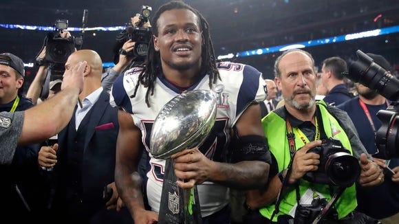 New England Patriots' Dont'a Hightower holds the Vince Lombardi Trophy after the NFL Super Bowl 51 football game against the Atlanta Falcons Sunday, Feb. 5, 2017, in Houston. The Patriots won 34-28. (AP Photo/Patrick Semansky)