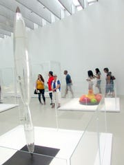 Visitors walk past exhibits in the Contemporary Art