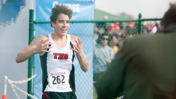 Jackson Bertoli of Terre Haute South reacts to winning the boys' race of the 33rd IHSAA Cross Country State Finals in Terre Haute, Saturday, Nov. 2, 2013.