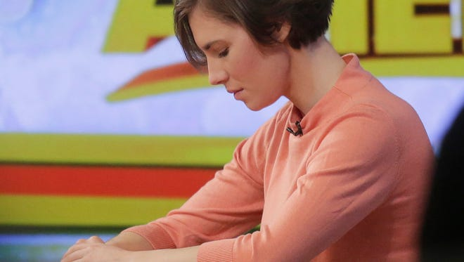 """Amanda Knox bows her head during a television interview on Friday in New York on ABC's """"Good Morning America."""""""