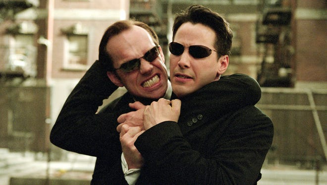 "Actors Hugo Weaving, left, and Keanu Reeves in a scene from ""The Matrix Reloaded."""