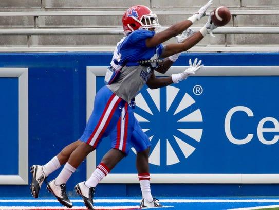 Louisiana Tech cornerback Roland Dunn intercepts a