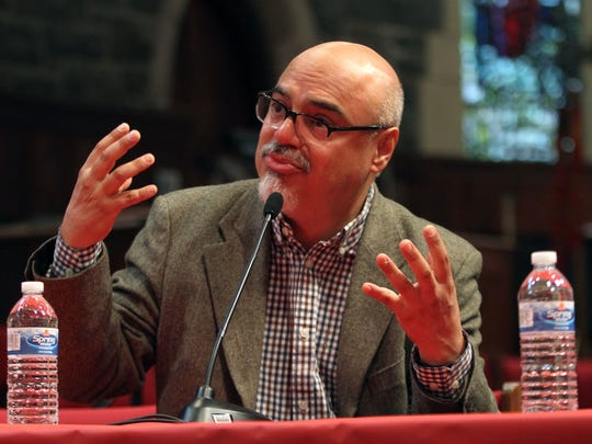 Pulitzer winning writer Hector Tobar speaks about his book, Deep Down Dark in the Church of the Redeemer as part of the 2015 Festival of Books, celebrating the power of the written word venues hosting more than 25 author talks and book signings in downtown Morristown. October 3, 2015, Morristown, NJ.