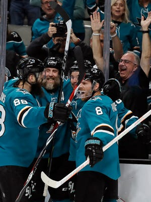 San Jose Sharks' Brent Burns, Joe Thornton, Tomas Hertl, and Joe Pavelski, from left, celebrate a goal by Hertl against the Vegas Golden Knights during the third period of Game 5 of an NHL hockey first-round playoff series Thursday, April 18, 2019, in San Jose, Calif. (AP Photo/Ben Margot)