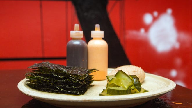The Snack Pack at Red Light Ramen, 1749 N. Farwell Ave., includes whipped Spam, spicy mayonnaise, pickled cucumber and sheets of crisp nori.