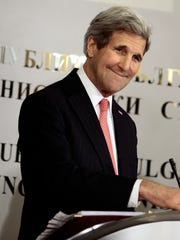 US Secretary of State, John Kerry, smiles during a