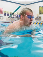 Jared Hunt swims laps in Delta's Pool Tuesday afternoon during a swim practice before sectional prelims.