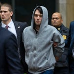 File photo taken in Dec. 2015 shows former hedge fund manager and pharmaceutical company executive Martin Shkreli (center) being escorted by law enforcement agents after he was arrested on a securities fraud indictment.