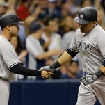 New York Yankees starting pitcher Masahiro Tanaka, of Japan, (19) shakes hands with manager Joe Girardi after retiring the Tampa Bay Rays during the seventh inning of a baseball game Friday, May 27, 2016, in St. Petersburg, Fla.