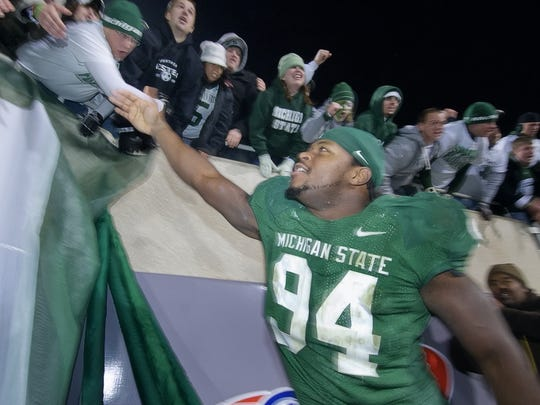 Jonal Saint-Dic of MSU celebrates with fans after the