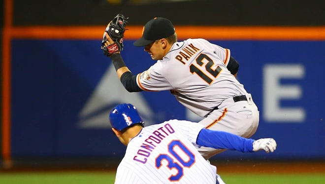 New York Mets leftfielder Michael Conforto (30) slides safely into second base after hitting an RBI double against the San Francisco Giants in the third inning at Citi Field.
