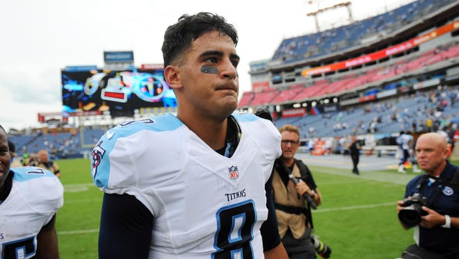 Sep 27, 2015; Nashville, TN, USA; Tennessee Titans quarterback Marcus Mariota (8) after a loss against the Indianapolis Colts at Nissan Stadium. The Colts won 35-33. Mandatory Credit: Christopher Hanewinckel-USA TODAY Sports