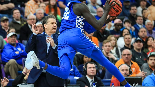 Kentucky's Wenyen Gabriel saves a loose ball late in the second half against Tennessee Sunday afternoon in St. Louis at the SEC Championship game.  Gabriel finished with 12 points and two blocks, three steals and six rebounds.The Wildcats got revenge after two losses this season to beat the Volunteers 77-72