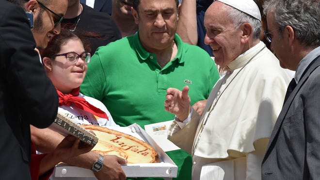 The pope likes pizza: Some pizza makers gifted him a pie on June 15, 2016 at St. Peter's square.
