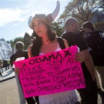 Paige Victoria, 23, of Cleveland protests in front of the White House on Friday.