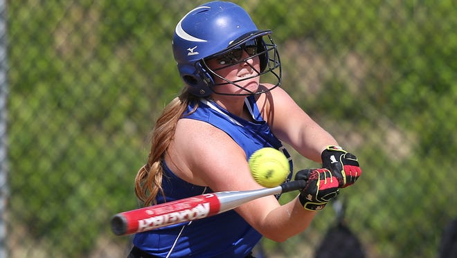 Hendrick Hudson's Shannon Karabaic (13) hits a single, driving in 2-runs against Nanuet during a Section 1 Class A girls softball playoff game at Frank G. Lindsey School in Montrose May 20, 2016. Hendrick Hudson won the game 9-2.