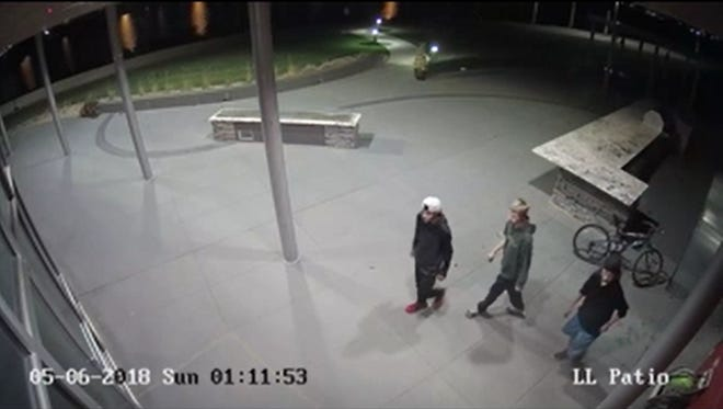 A scene from a surveillance video released by Sioux Falls police of three vandalism suspects.