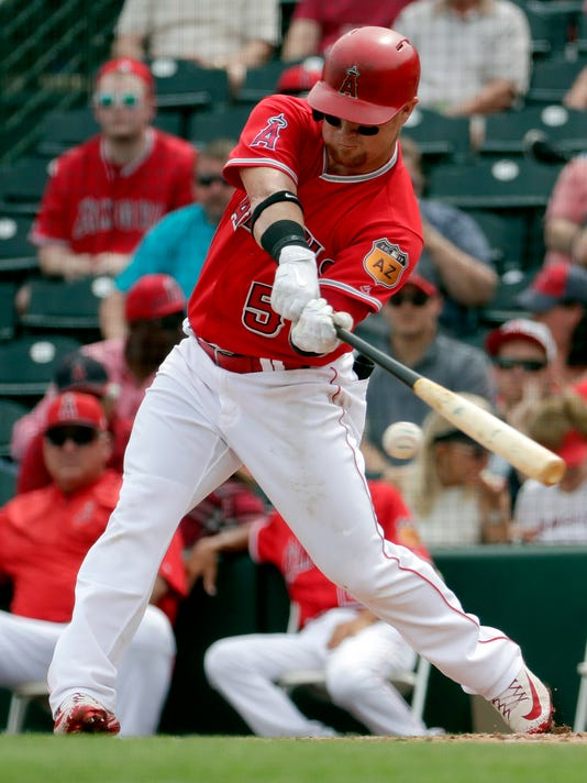 Los Angeles Angels' Kole Calhoun follows through on a base hit during the first inning of a spring training baseball game against the Texas Rangers, Wednesday, March 22, 2017, in Tempe, Ariz. (AP Photo/Matt York)