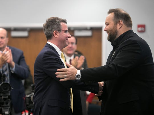 Jan-Erik Hustrulid, left, is congratulated by Cory O'Donnell after he was named The News-Press Young Professional of the Year on Tuesday at FGCU.