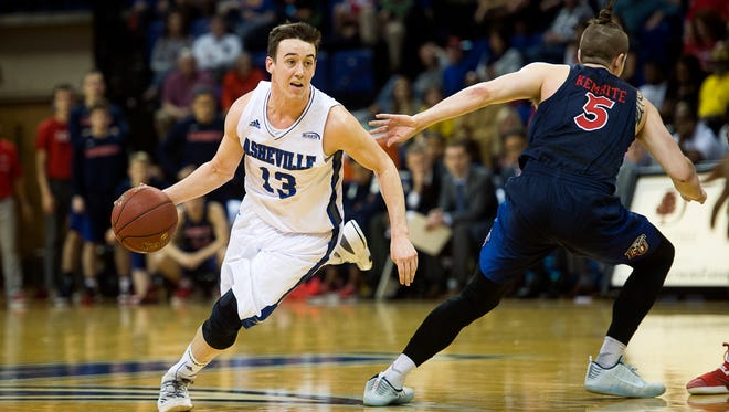 David Robertson drives to the basket Saturday afternoon during the Big South regular season championship game against Liberty at the Kimmel Arena. UNC Asheville defeated Liberty 63-45.