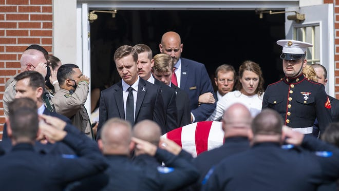 The body of Henderson County sheriff's deputy Ryan Hendrix is carried out of Mud Creek Baptist Church following his funeral service on Sept. 18, 2020. Hendrix died in the line of duty.