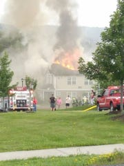 Firefighters attempt to put out a large fire at Poets