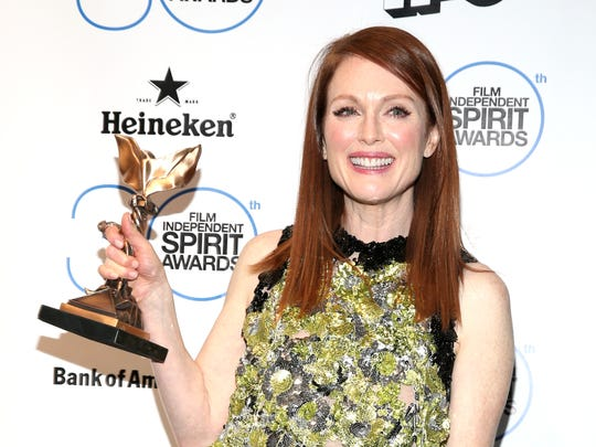 Julianne Moore poses with the award for best female