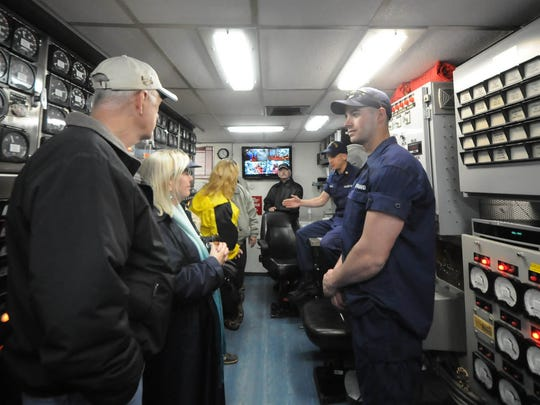 Visitors tour the control room aboard U.S. Coast Guard cutter Mobile Bay during a past Rotary Club Shipyard Tour. The Mobile Bay once again will be available for tours during this year's Shipyard Tours.