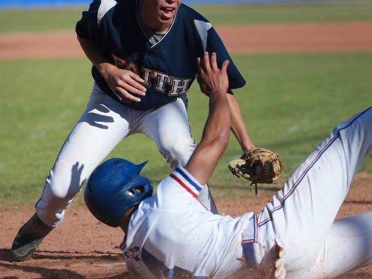 Pablo Cortes of Faith Christian puts out sliding Americas baserunner Adrian Gomez at home plate Saturday.