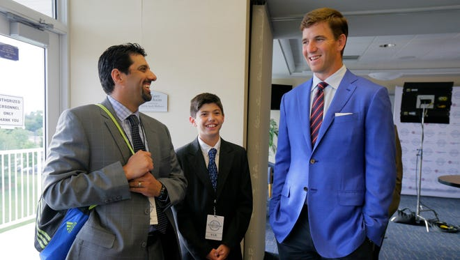 Giants quarterback Eli Manning talks to 11-year-old Joseph Pierro of Manahawkin and his father, Anthony, in the VIP room during the Asbury Park Press Jersey Shore Sports Awards at the MAC on the campus of Monmouth University in West Long Branch, NJ Monday June 13, 2016.