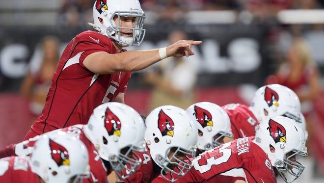Cardinals quarterback Drew Stanton (5) calls signals against the Detroit Lions during the second half at University of Phoenix Stadium. The Cardinals won 14-6.