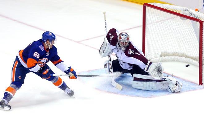 New York Islanders left wing Nikolai Kulemin (86) beats Colorado Avalanche goalie Semyon Varlamov (1) for a short-handed goal during the second period at Nassau Veterans Memorial Coliseum.